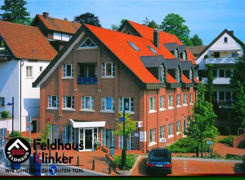 Клинкерный кирпич Feldhaus Klinker K400NF carmesi liso
